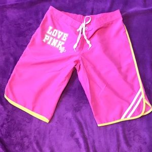 Pink Victoria Secret, pink and yellow long shorts.
